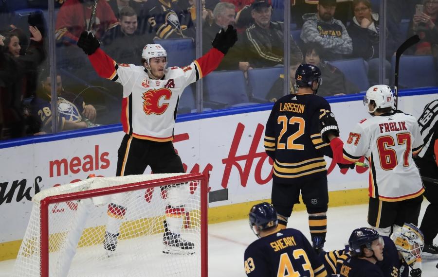 Calgary's Matthew Tkachuk celebrates his tying goal in the third period Wednesday.  (Harry Scull Jr./Buffalo News)