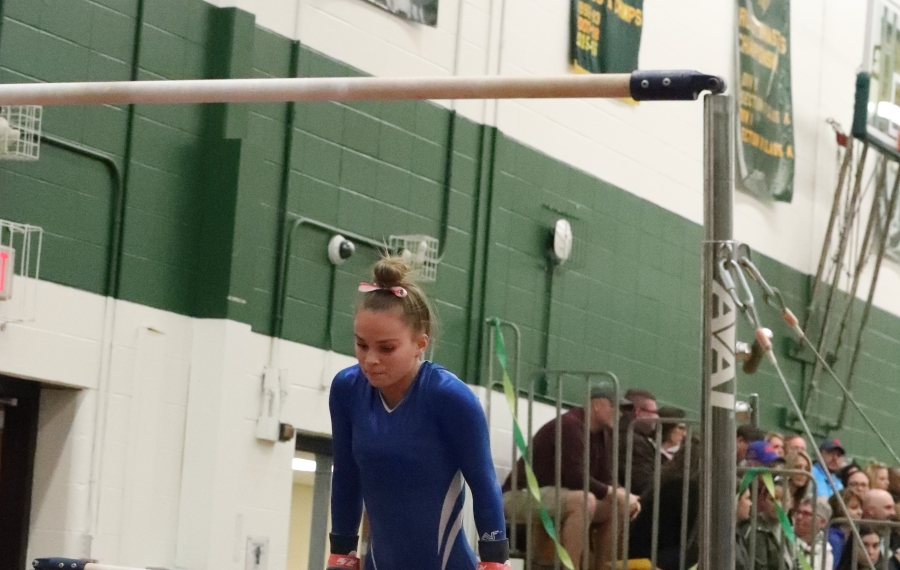 Jenna Blair of Frontier performs on the bars during the Section VI Gymnastics championships at Williamsville North Friday (James P. McCoy/Buffalo News)