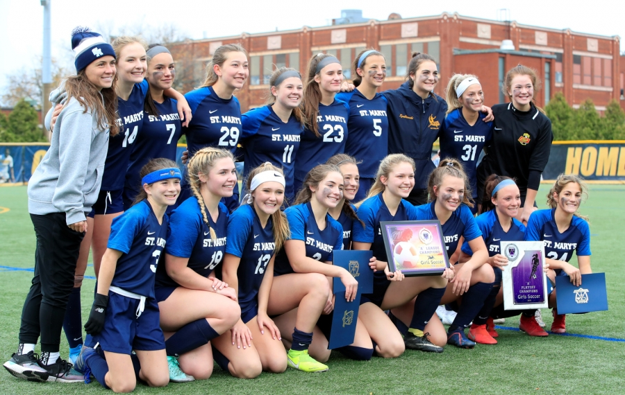 St. Mary's celebrates a 3-0 victory over Nichols for the Monsignor Martin A girls soccer championship Saturday (Harry Scull Jr./Buffalo News)