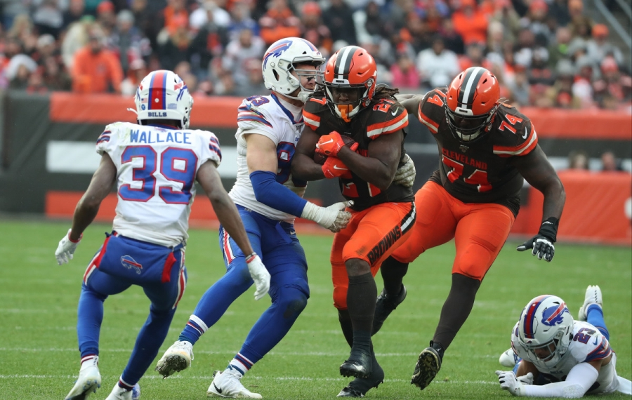 Browns running back Kareem Hunt (27) is tackled by defensive end Trent Murphy (93) in the third quarter. (James P. McCoy/Buffalo News)