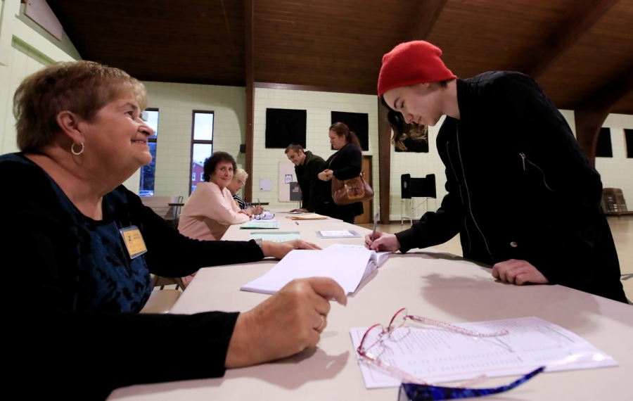Molly Kropczynski,19, signs in to vote for the first time at the St. Aloysius Parish Hall on Tuesday, Nov. 5, 2019.  (Harry Scull Jr./Buffalo News)