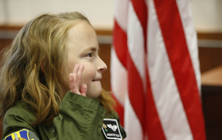 Tianna Colarusso, 9, of Delevan, became an honorary Airman for a Day at the Niagara Falls Air Reserve Station, as part of the Stone's Buddies program at Oshei Children's Hospital,  Wednesday, Nov. 6, 2019.  Tianna gets into her flight suit and takes her commissioning oath. (Sharon Cantillon/Buffalo News)