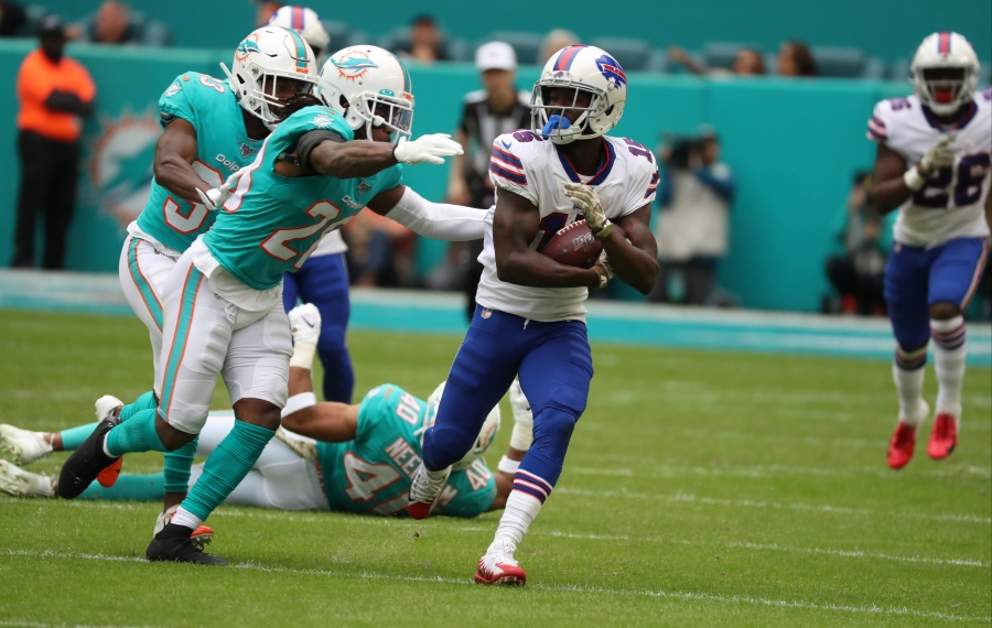Bills wide receiver John Brown catches a pass for a first down past Miami Dolphins free safety Reshad Jones. (James P. McCoy/Buffalo News)