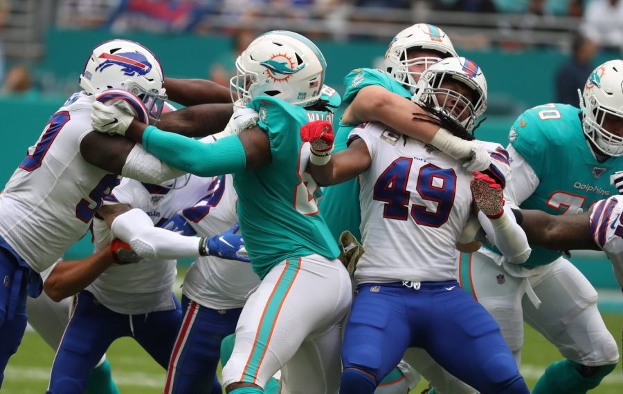 Buffalo Bills middle linebacker Tremaine Edmunds (49) is held by Miami guard Jesse Davis (77) in the second quarter. (James P. McCoy/Buffalo News)