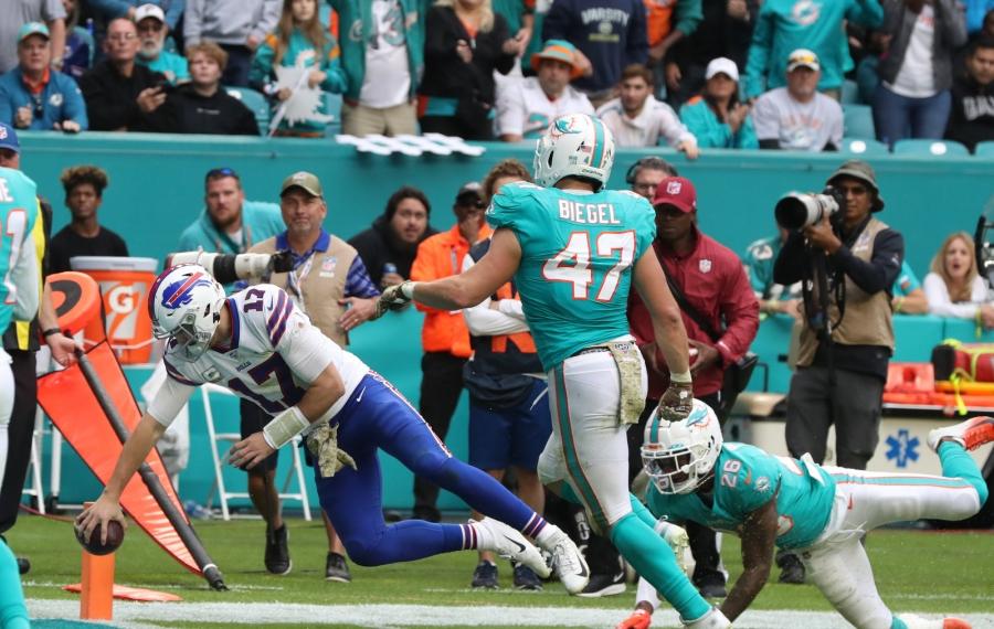 Buffalo Bills quarterback Josh Allen (17) rushes for a touchdown against Miami Dolphins defensive back Steven Parker (26) in the third quarter at Hard Rock Stadium in Miami Gardens , Fl on Sunday, Nov. 17, 2019.  James P. McCoy/Buffalo News