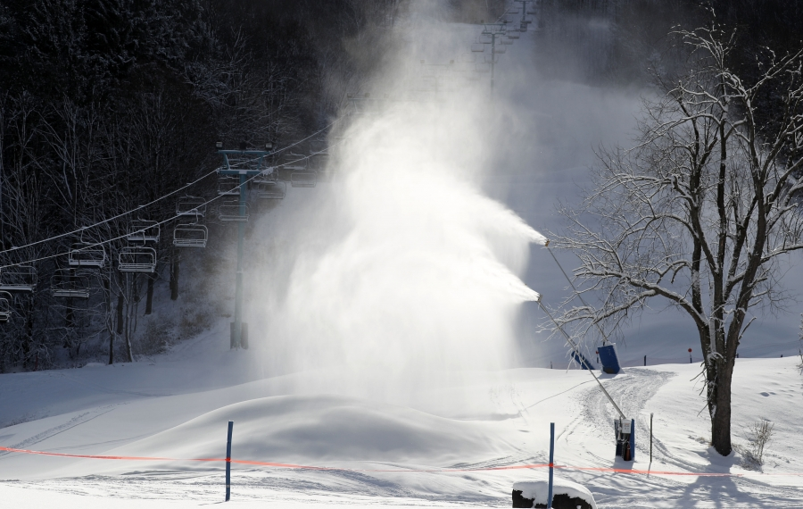 Unseasonably cold temperatures and 230 snow guns making  huge piles of snow, allow Holiday Valley to build a base for the opening, which is scheduled for Nov. 29.      (Mark Mulville/Buffalo News)
