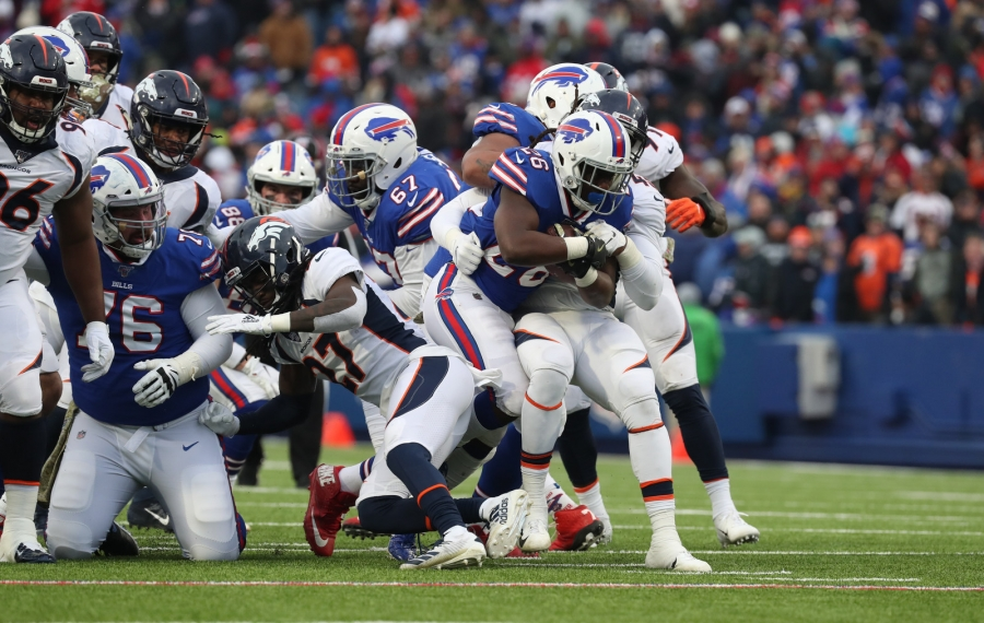 Buffalo Bills running back Devin Singletary (26) rushes for a first down over Denver Broncos linebacker A.J. Johnson (45) in the third quarter at New Era Field on Sunday, Nov. 24, 2019.  (James P. McCoy/Buffalo News)