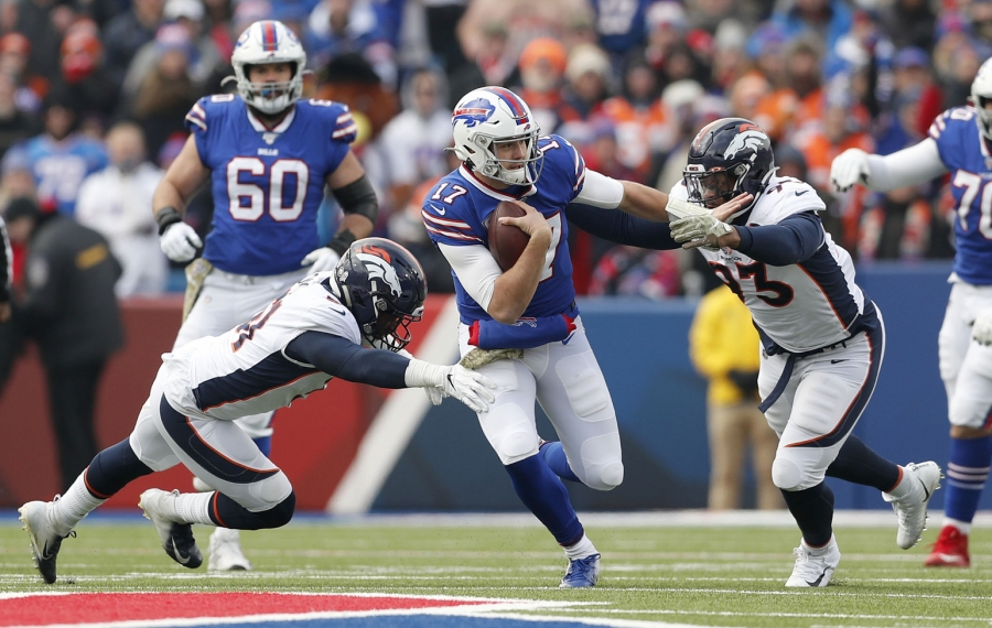 Josh Allen eludes Denver inside linebacker Todd Davis (51) and Denver Broncos defensive end Dre'Mont Jones (93) in the first quarter at New Era Field. (Mark Mulville/Buffalo News)