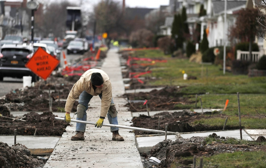 The longtime reconstruction project on Wardman Road in Kenmore is coming to a close. Work largely should be completed on Monday. Subcontractor Millennium Concrete pours the driveway aprons. Dave Braun finishes a transition piece. (Sharon Cantillon/Buffalo News)