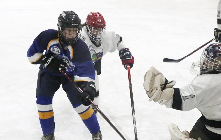 West Seneca-Hamburg-Eden's Riley Andzel battles Kenmore-Grand Island's Isabelle Bourgeault for the puck in the second period at West Seneca Rink in West Seneca,  on Monday, Nov. 25, 2019.  (James P. McCoy/Buffalo News)