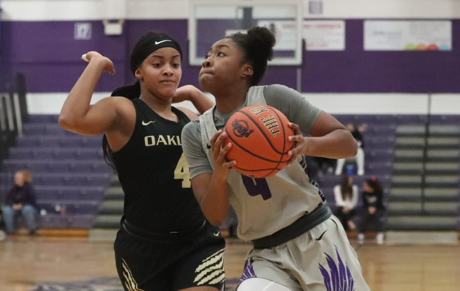 Niagara Purple Eagles guard Jai Moore (4) puts up a shot over Oakland's  Jalisha Terry in the first quarter at Gallagher Center at Niagara University in Lewiston,  on Monday, Nov. 25, 2019. (James P. McCoy/Buffalo News)