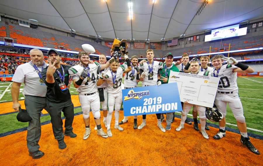 Clymer-Sherman-Panama celebrate a victory over Moriah during to win the NYSPHSAA Class D State Final High School football game at the Carrier Dome on Nov. 29.  (Harry Scull Jr./Buffalo News)