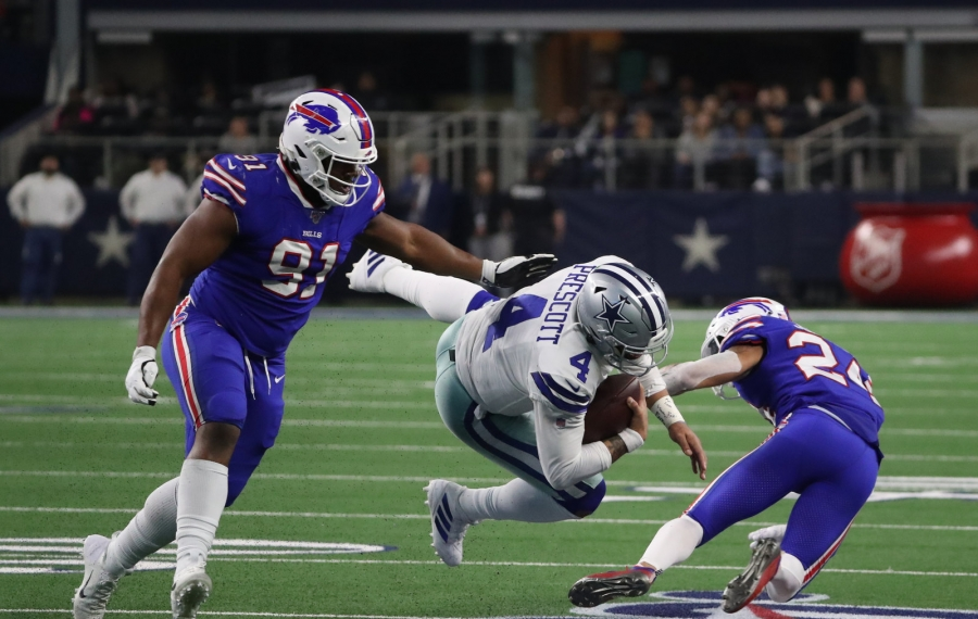 Buffalo Bills defensive tackle Ed Oliver (91) and Buffalo Bills cornerback Taron Johnson (24) stops Dallas Cowboys quarterback Dak Prescott (4) short of a first down in the fourth quarter at AT&T Stadium in Arlington, TX on Thursday, Nov. 28, 2019.  James P. McCoy/Buffalo News