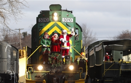 Santa arrived at the Village of Hamburg's historic Erie Railroad Depot aboard a vintage 1950s era diesel locomotive on Saturday, Nov. 30, 2019. He met with children inside the depot before departing on the Santa Express ride to the Eden Valley. The event was coordinated by Artcraft Toy Trains and Buffalo, Cattaraugus & Jamestown Scenic Railway. Santa Express rides three times daily every Saturday and Sunday through Dec. 15.