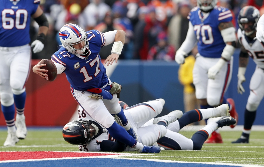 Bills quarterback Josh Allen is tackled by Denver's Dre'Mont Jones as he dives for a first down in the first quarter. (Mark Mulville/Buffalo News)
