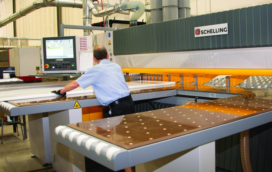 A worker at Curbell Plastics cuts a sheet of plastic for a customer on a CNC panel saw. (Courtesy of Curbell Plastics)