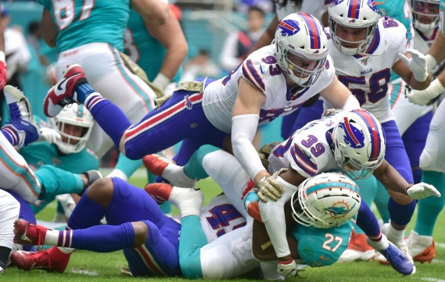Bills' Trent Murphy and Levi Wallace tackle Kalen Ballage of the Dolphins. (Getty Images)