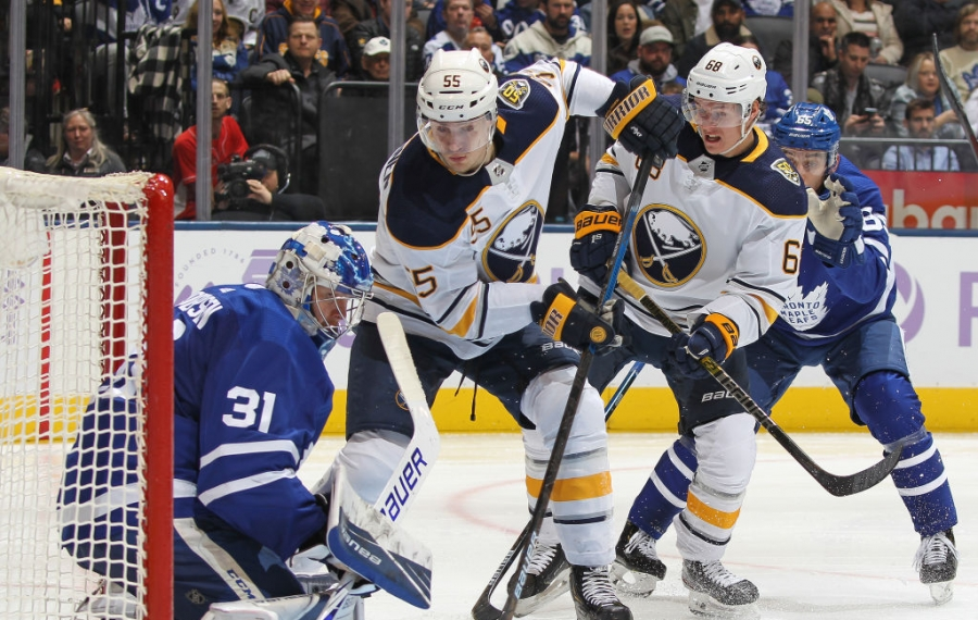 TORONTO, ON - NOVEMBER 30:  Rasmus Ristolainen #55 of the Buffalo Sabres slips a puck past Frederik Andersen #31 of the Toronto Maple Leafs during an NHL game at Scotiabank Arena on November 30, 2019 in Toronto, Ontario, Canada.  The Maple Leafs defeated the Sabres 2-1 in overtime. (Photo by Claus Andersen/Getty Images)
