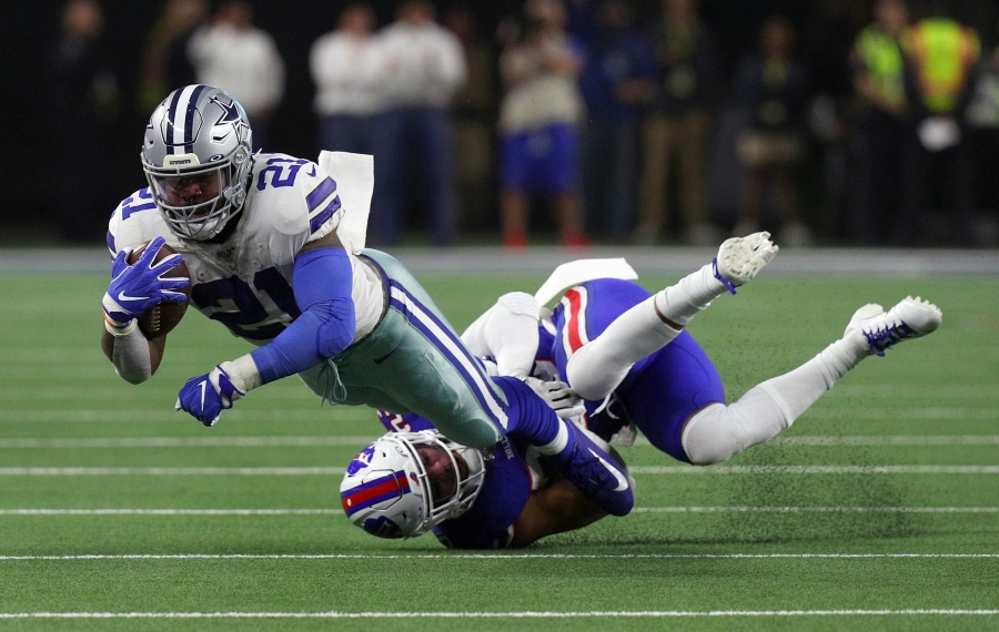 Ezekiel Elliott gets tackled by Micah Hyde in the first quarter at AT&T Stadium. (Getty Images)