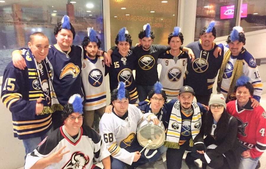 The Sabres' Czech-Slovak Fan club gathers for a group shot in Ericsson Globe. Leader Viktor Maudr is in front holding the drum (Mike Harrington/Buffalo News).