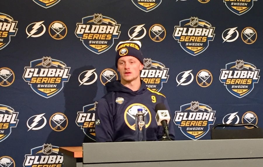 Jack Eichel speaks to reporters Friday in Stockholm at the official NHL dais for the Global Series. (Mike Harrington/Buffalo News)