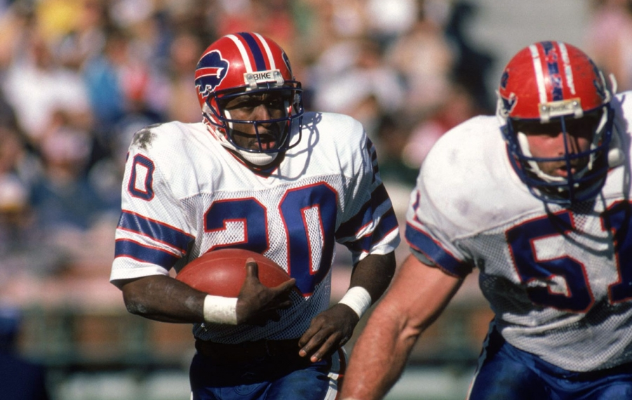 Running back Joe Cribbs of the Buffalo Bills follows his lead blocker Jim Ritcher against the San Diego Chargers in 1985. (George Rose/Getty Images)