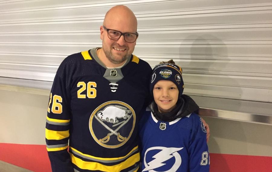 Johan Eskhult, left, of Uppsala, Sweden, sports a Rasmus Dahlin jersey at Thursday's Sabres practice while his son Albin wears the sweater of Tampa Bay's Nikita Kucherov. (Mike Harrington/Buffalo News)