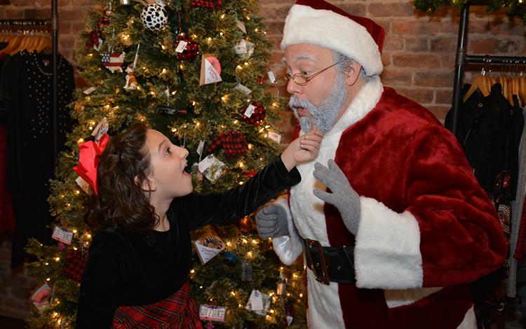 """Oh my goodness, it is real!"" Susan Walker (Isabella Bindeman) tests Kris Kringle (Elliot Fox) in Miracle on 34th Street: A Live Musical Radio Play.  -photo by Gary McBride"
