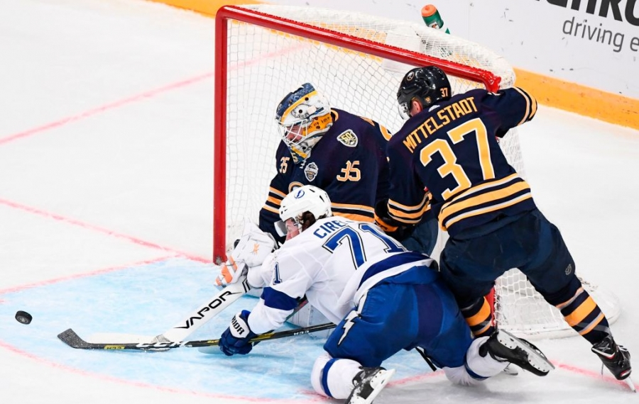 Linus Ullmark makes a save on Tampa Bay's Anthony Cirelli as Casey Mittelstadt helps out during the first period Friday in Stockholm. (Getty Images)