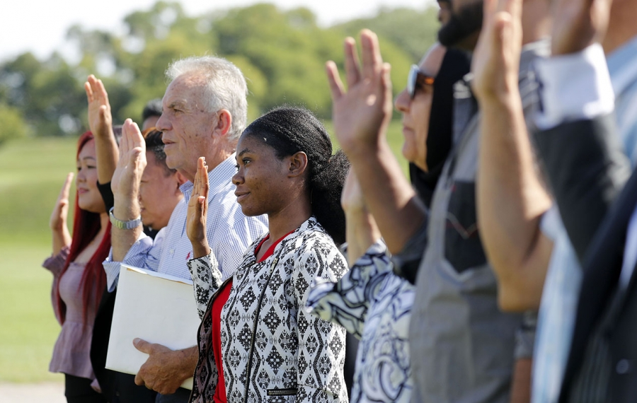 Twenty people take the oath of allegiance to become U.S. citizens during a naturalization ceremony at Old Fort Niagara in Youngstown in August. (Mark Mulville/News file photo)