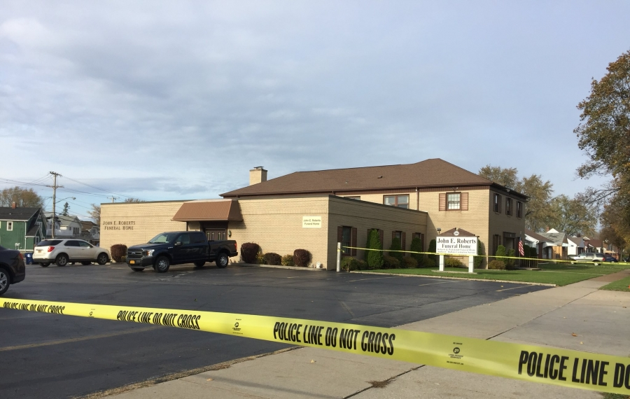 """Yellow crime scene tape could be seen Monday afternoon outside the John E. Roberts Funeral Home on Grover Cleveland Highway. Charles Durante, a funeral home director there, was found in the middle of the road early Monday morning and later died. Police are treating it as a """"suspicious death."""" (Aaron Besecker/Buffalo News)"""