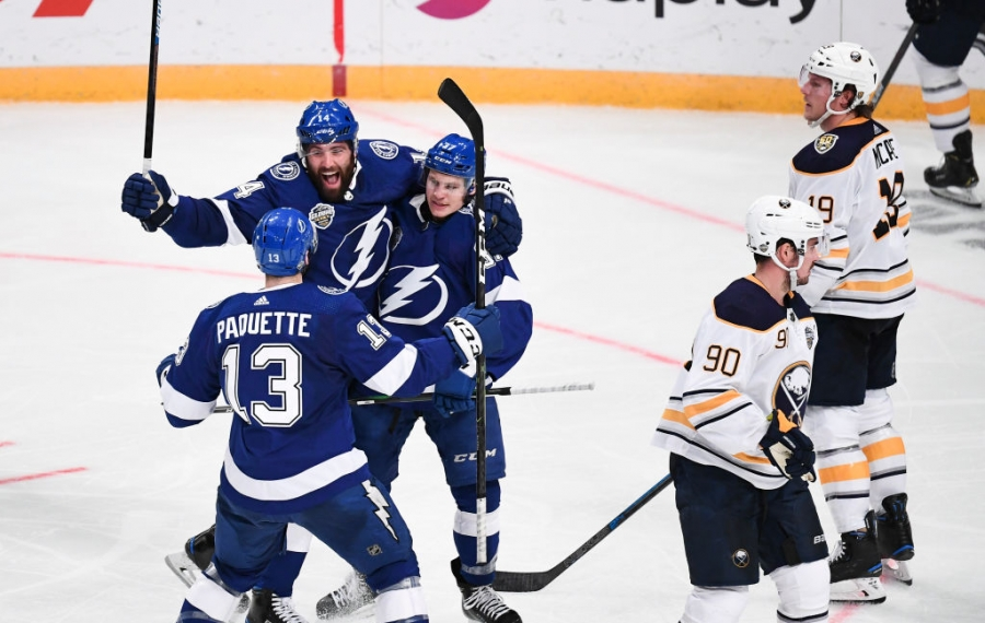 Yanni Gourde of the Tampa Bay Lightning celebrates his third-period goal in front of frustrated Sabres Jake McCabe (19) and Marcus Johansson (Getty Images).