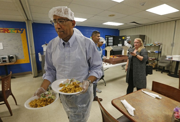 Volunteer Marvin Wilson runs meals to tables of hungry people at the Matt Urban Hope Center. The Hope Center is part of the Lt. Col. Matt Urban Human Services Center that helps those in need on Buffalo's East Side, in Cheektowaga and parts of West Seneca (Robert Kirkham/Buffalo News)