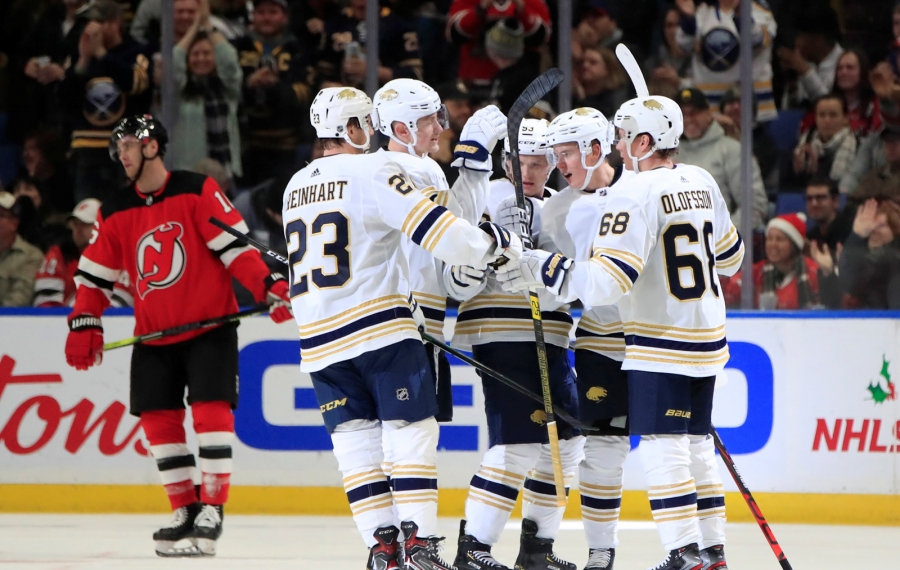 Buffalo Sabres defenseman Henri Jokiharju celebrates his goal with teammates against the New Jersey Devils during the second period at the KeyBank center on Monday, Dec. 2, 2019. (Harry Scull Jr./Buffalo News)