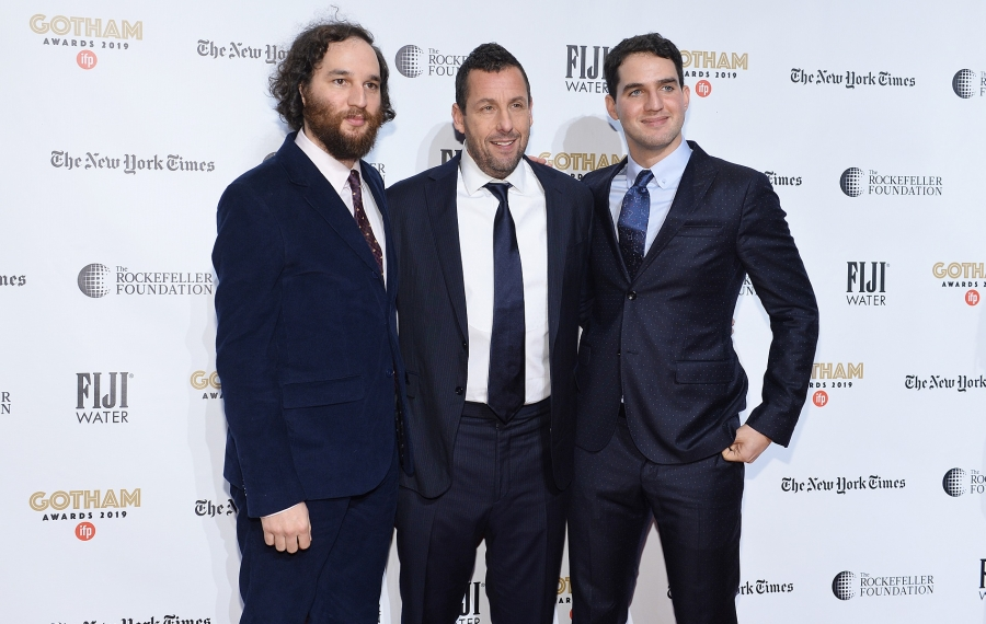 Adam Sandler, flanked by Josh Safdie, left, and Benny Safdie. (Photo by Noam Galai/Getty Images for FIJI Water)