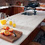 Witch Hazel Corian Countertops In Kitchen