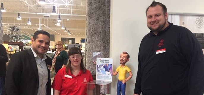 Employees at Bob's Redlands California location posing with a Special Olympian.