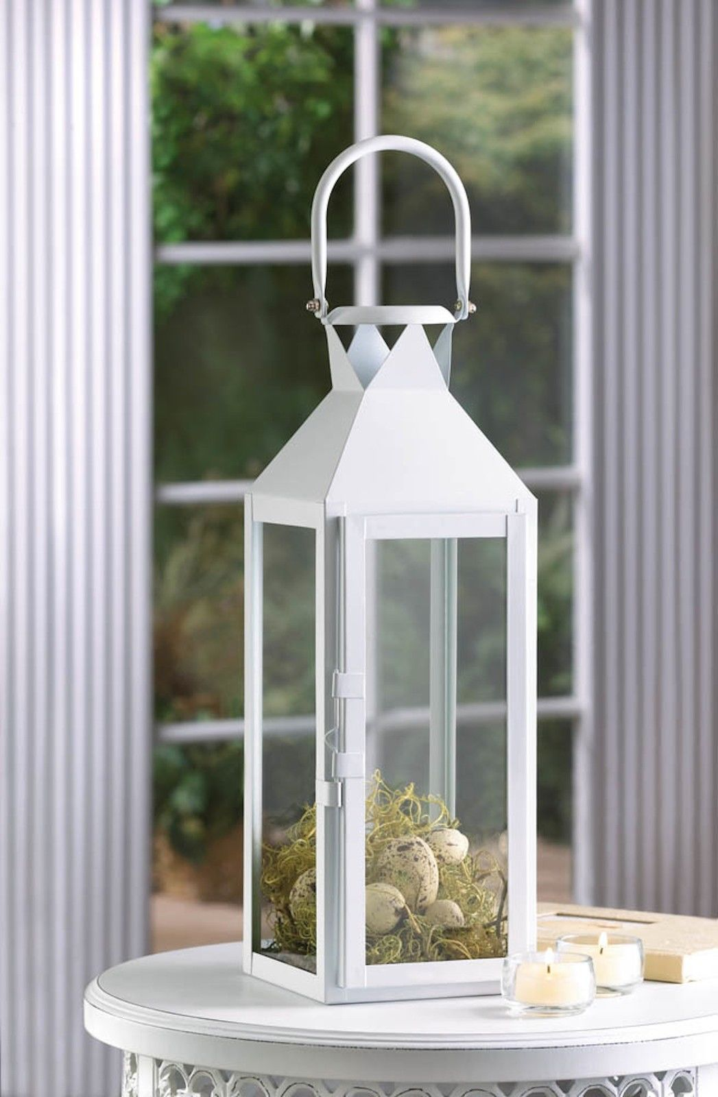 Large white candle lantern wedding centerpieces