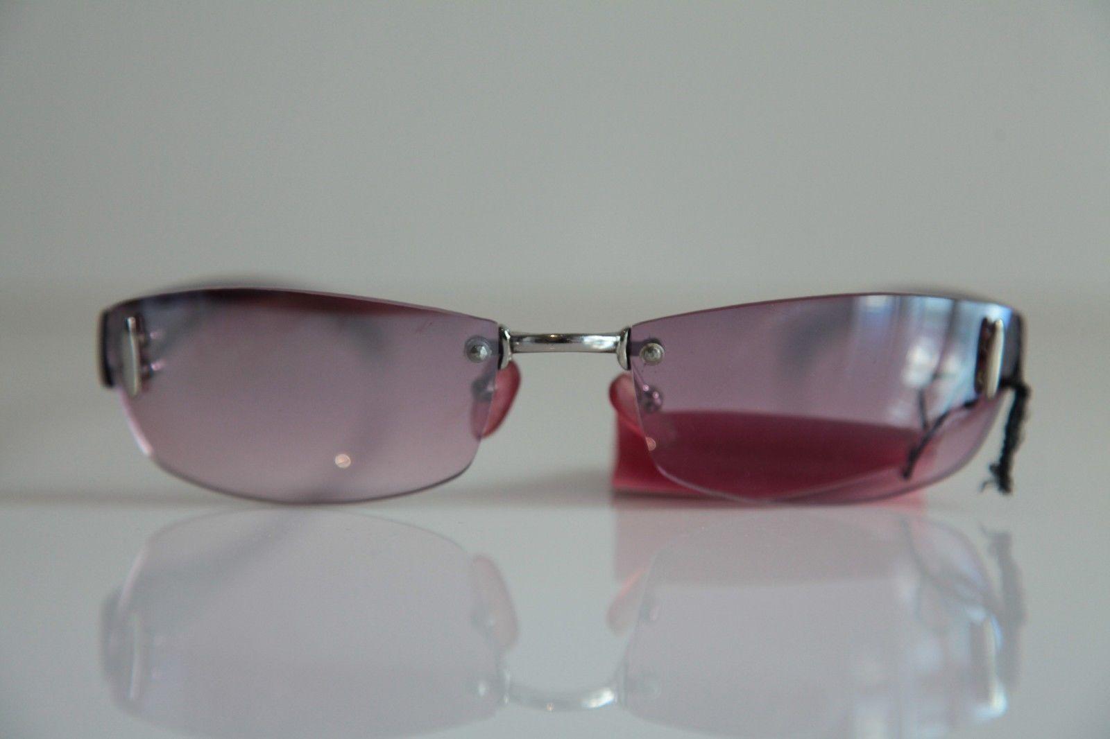 Rimless Glasses Nz : Rimless frame, Chrome, Smoke Purple , Purple lenses by ...