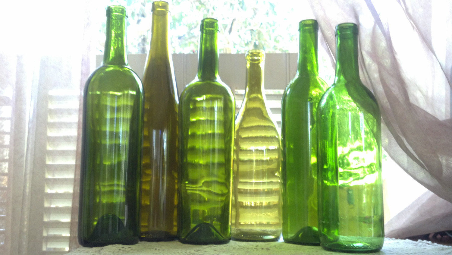 Recycled empty wine bottles for crafts slumping painting for Empty wine bottles