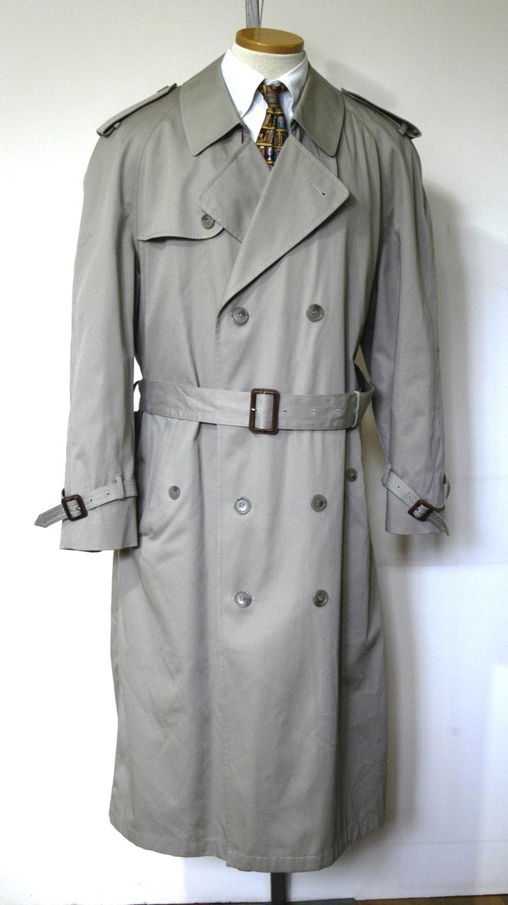 A trench coat or trenchcoat is a raincoat made of waterproof heavy-duty cotton gabardine drill, leather, or poplin. A typical trench coat is a ten-buttoned, double-breasted long coat made with tan, black, khaki, or beige fabric. Trench coats often have cuff straps, raglan sleeves, shoulder straps and a belt.