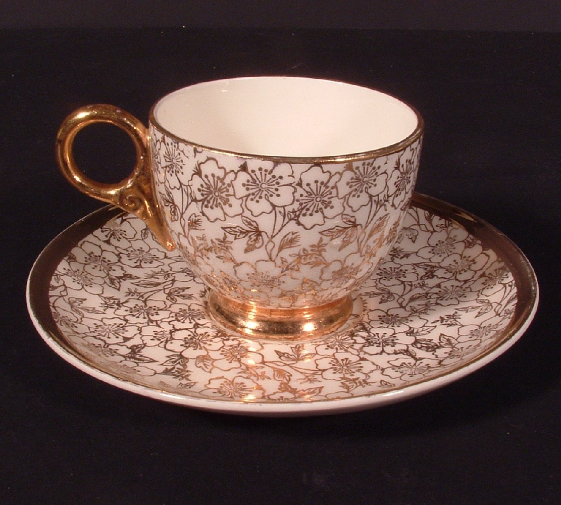 Warranted 22K Gold Porcelain Demitasse Tea Cup and Saucer