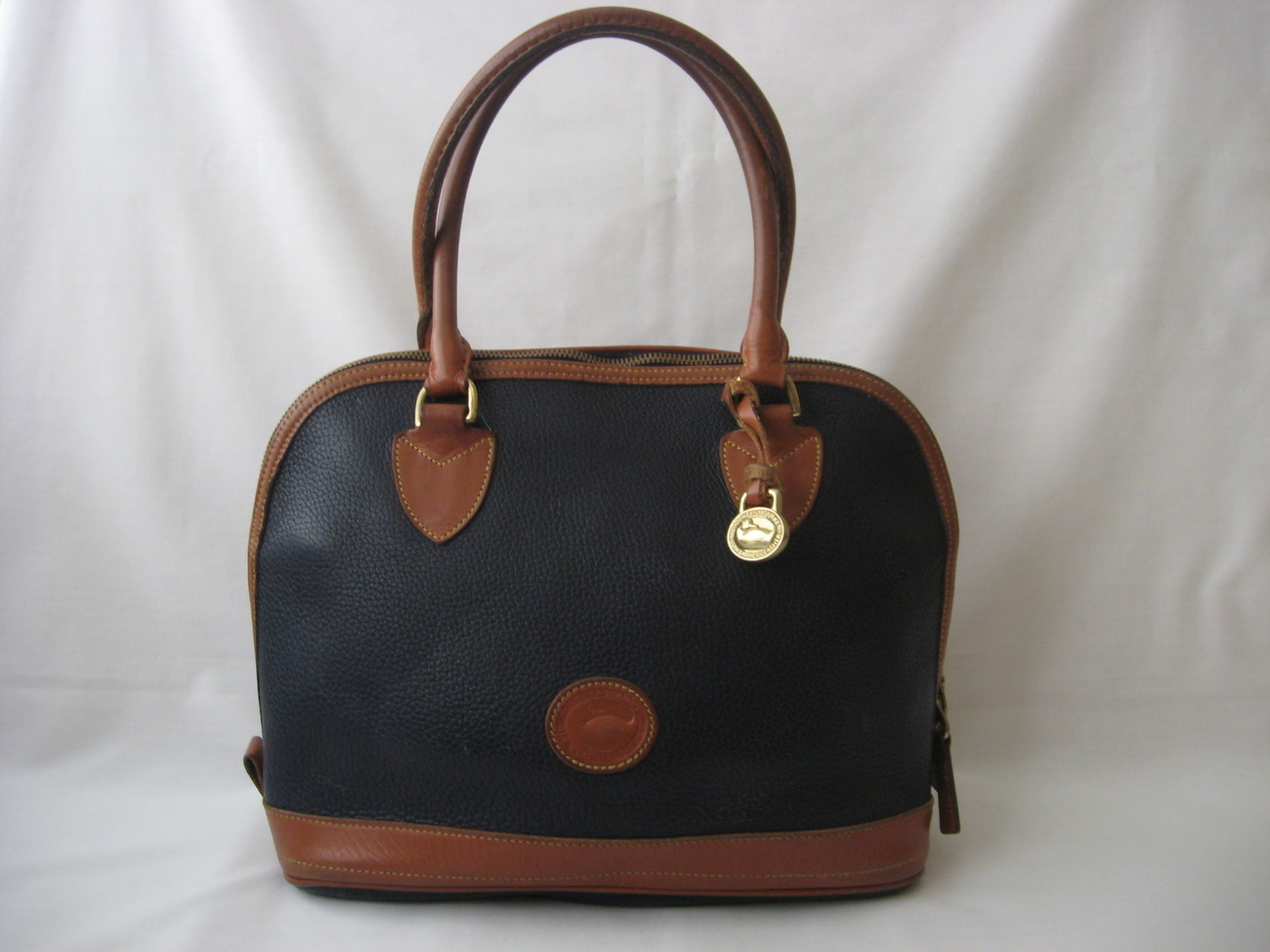 Dooney & Bourke Bags This blog is a labor of love of vintage All Weather Leather Dooneys and I am always glad to help with identifying and authenticating bags free of charge. It is my way of contributing to the knowledge base out there in hopes it helps prevent fraudulent sales from occurring.