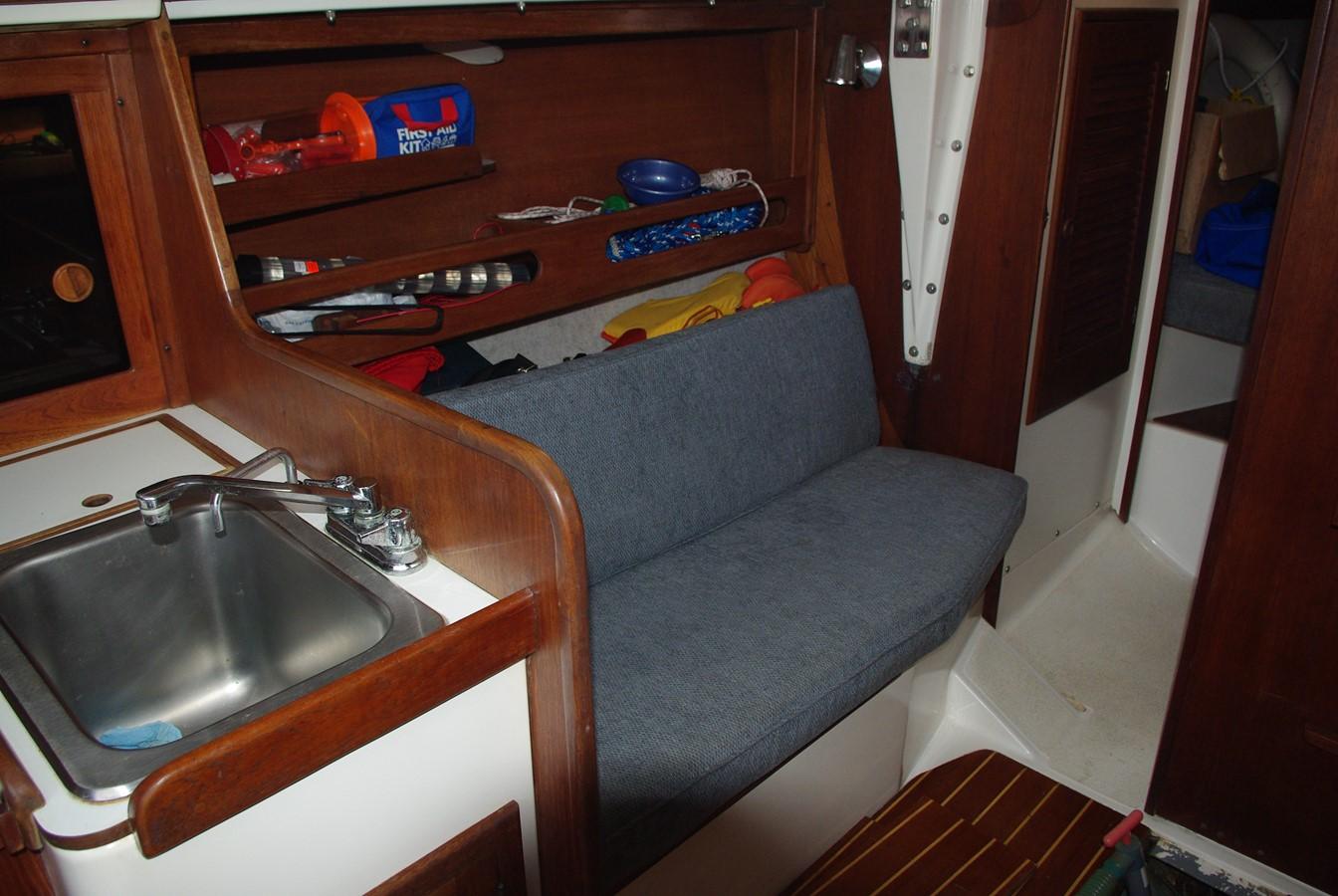 Port settee & sink 1984 TARTAN YACHTS  Aft Cockpit 1454960
