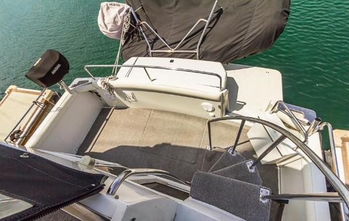 Cockpit w/ Dinghy on Davit 1999 CARVER 404 Cockpit Motor Yacht Motor Yacht 1842240