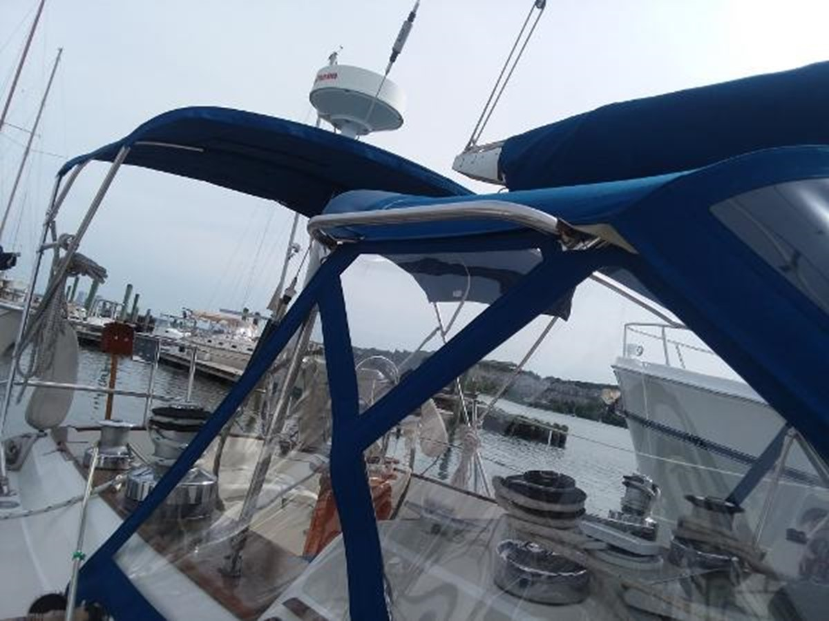 Dodger with handrails on both sides of the boat 1989 SABRE YACHTS 38 MKII Sloop 2207623