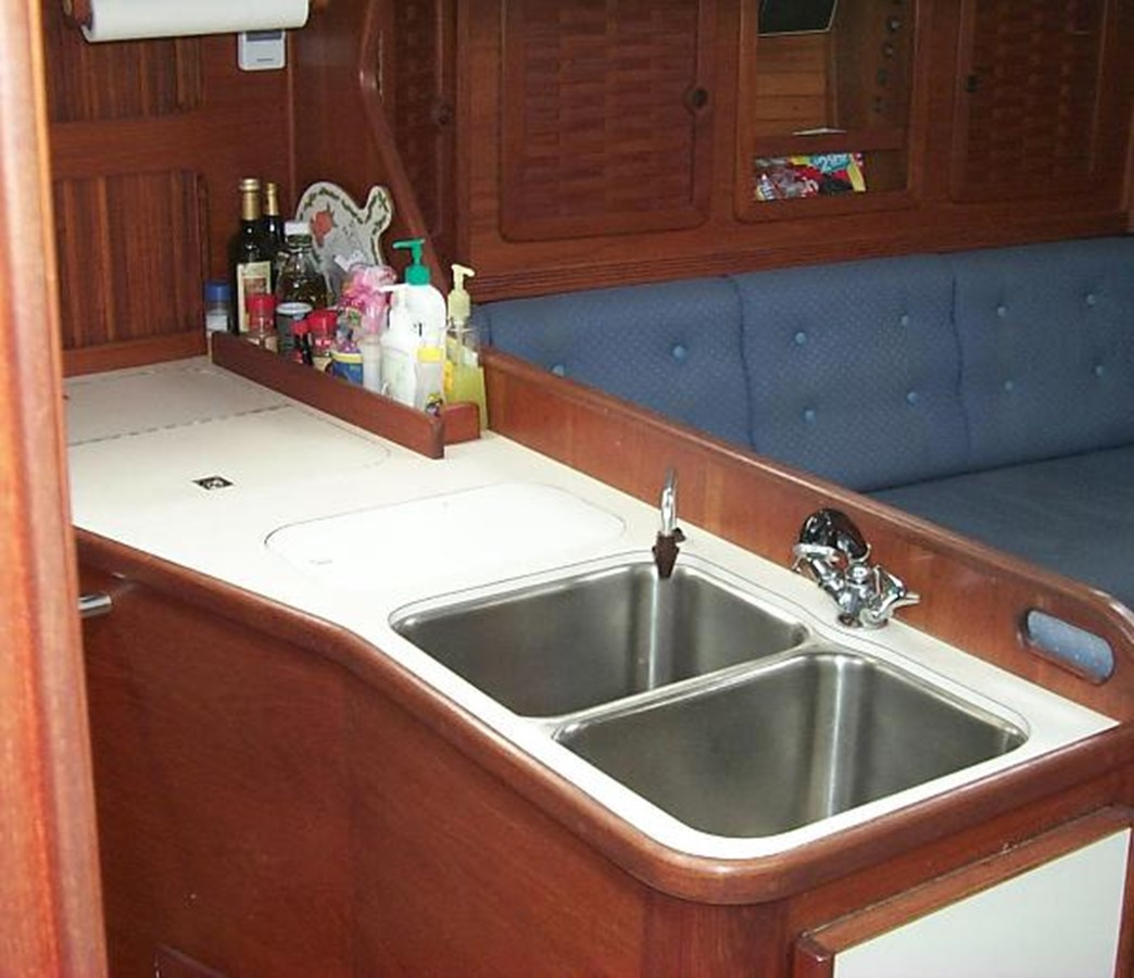 Galley with double sinks and generous counter space 1989 SABRE YACHTS 38 MKII Sloop 2207649