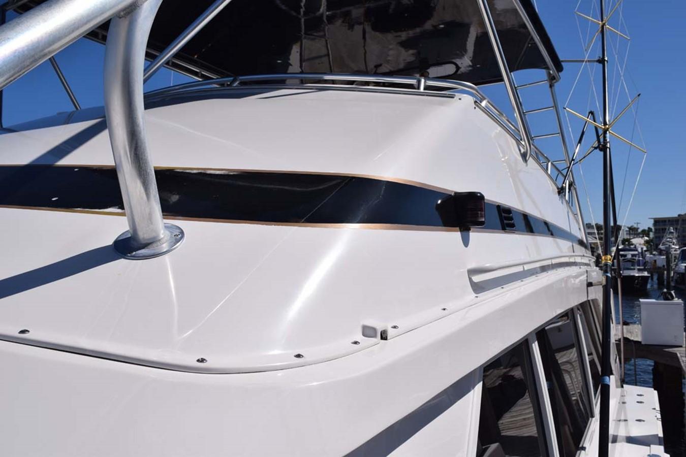 Bow to Stern Walk on Port Side 1998 BERTRAM 60 Convertible Sport Fisherman 2531931
