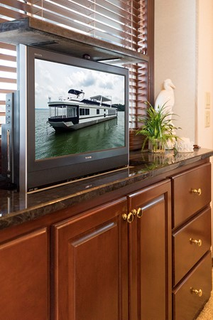 TV in the master stateroom 2007 FANTASY YACHTS 112' x 21' Houseboat 2551916
