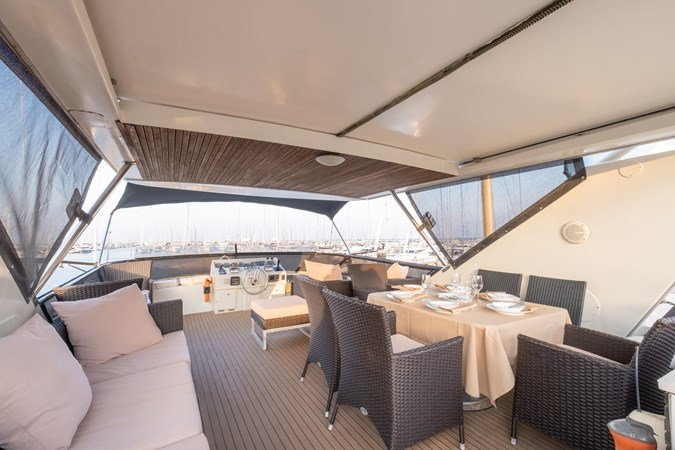 Guy Couach 2701 TIENNA - Flybridge Dining 1 1991 GUY COUACH 2701 Motor Yacht 2680657